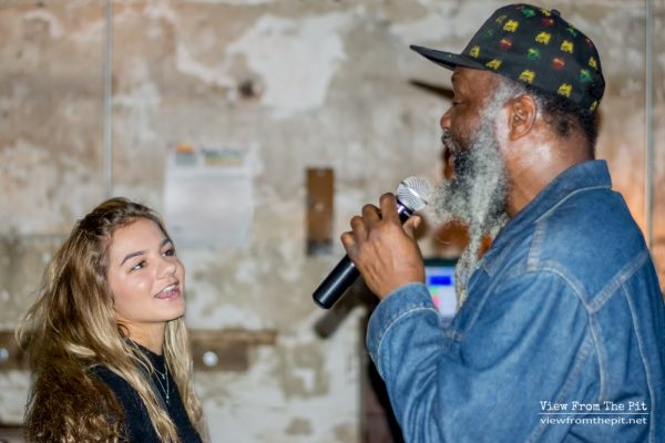 Winston Irie singing to a fan at Coastal Kitchen