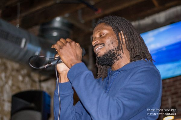 Chad J. White singing with IRIEspect at Coastal Kitchen